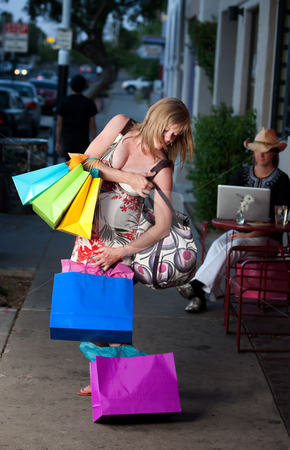 Woman with bags stock photo, Pregnant woman struggling with multiple shopping bags by Scott Griessel