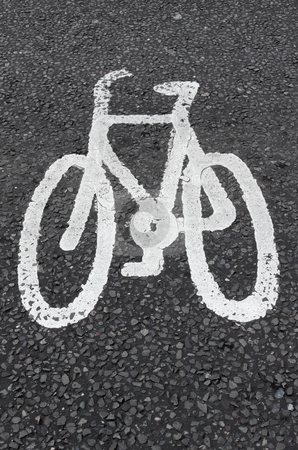White cycle lane sign on asphalt. stock photo, White cycle lane sign on asphalt. by Stephen Rees