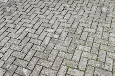 Gray paving cobblestone blocks pattern background. stock photo, Gray paving cobblestone blocks pattern background. by Stephen Rees