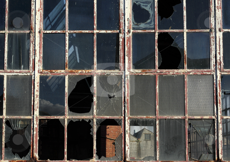 Close up of broken windows in a derelict building. stock photo, Close up of broken windows in a derelict building. by Stephen Rees