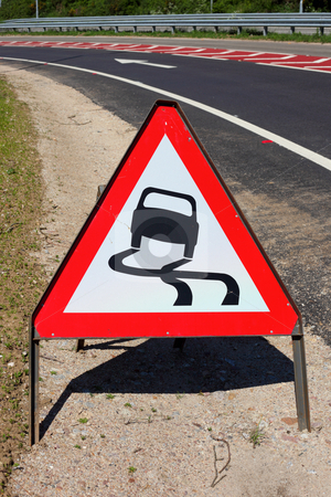 British slippery road surface warning sign. stock photo, British slippery road surface warning sign. by Stephen Rees