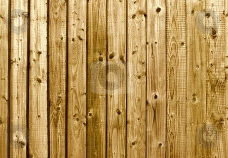 A brown wooden fence close up background. stock photo, A brown wooden fence close up background. by Stephen Rees