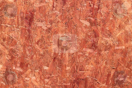 Orange coated recycled oriented strand board close up. stock photo, Orange coated recycled oriented strand board close up. by Stephen Rees