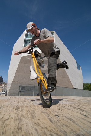 Bmx training stock photo, Bmx flatland training on a sunny day in a  city. by Homydesign