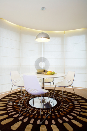 Modern interior with dining table stock photo, Modern interior with dining table by Peter Iliev