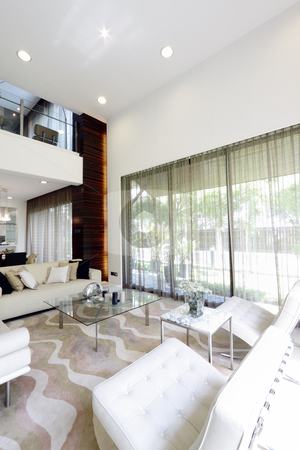Living room stock photo, Interior view of a modern living room by Adrin Shamsudin