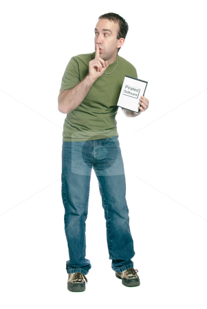 Pirated Computer Software stock photo, A young man holding a dvd case with pirated computer software in it and telling someone to shhh, isolated against a white background. by Richard Nelson
