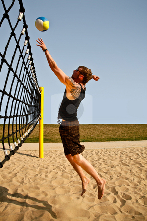 Volley Net Jump stock photo, Dynamic Jump To The Net For A Volleyball Hit by Nick Fingerhut
