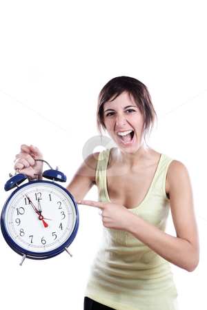 Pointing The Time stock photo, Expressive Young Woman Holding A Big Alarm Clock And Pointing The Time by Nick Fingerhut