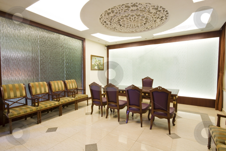 A large mahogany conference room table with leather chars stock photo, A large mahogany conference room table with leather chars by Keng po Leung