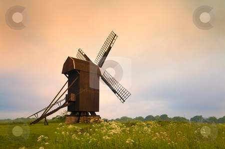 Old wooden windmill stock photo, Old wooden windmill in South Sweden in the light of the early morning. by Kai Schirmer