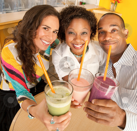 Friends Holding Smoothies stock photo, A group of friends are holding smoothies and smiling at the camera.  Square shot. by Scott Griessel