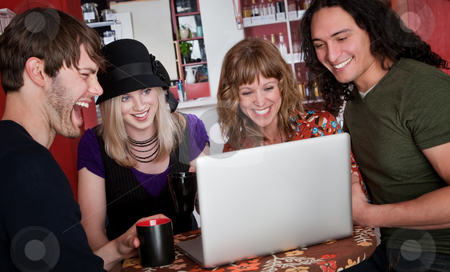 Four friends stock photo, Four friends viewing something on a laptop in a cafe by Scott Griessel