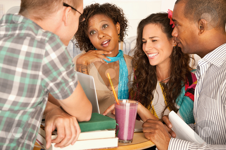 Friends Socializing stock photo, A group of friends are talking and smiling with each other.  Horizontal shot. by Scott Griessel