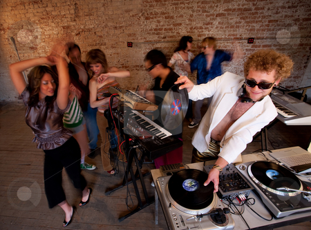 1970s Disco Music Party stock photo, Changing records at a 1970s Disco Music Party by Scott Griessel