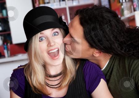 Interracial kiss alone at a cafe stock photo, Interracial kiss alone at a cafe by Scott Griessel
