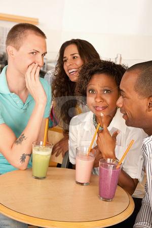 Two Couples Dining Out stock photo, Two couples at a cafe drinking frozen beverages. Vertical shot. by Scott Griessel