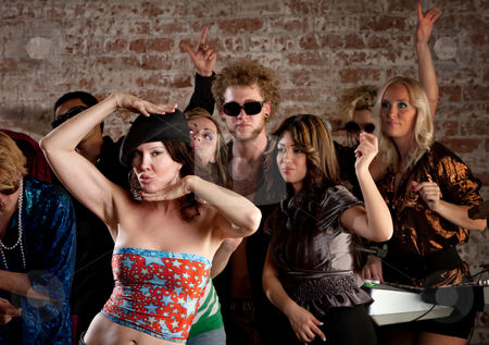 Woman dancing with friends at disco party stock photo, Dancing people at 1970s Disco Music Party by Scott Griessel