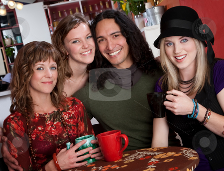 Four young friends  stock photo, Four young friends enjoying coffee at a bistro by Scott Griessel