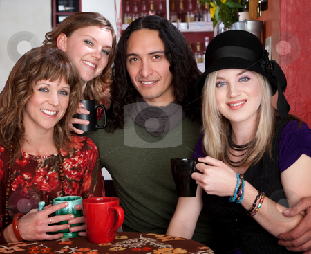 Four friends  stock photo, Four friends smiling and enjoying drinks at a cafe by Scott Griessel