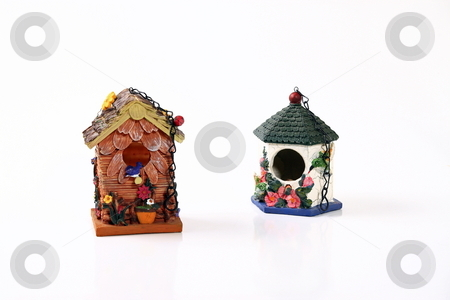 Bird Houses stock photo, Hanging ceramic bird houses with chaines by Jack Schiffer