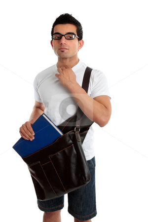 Male student looking sideways stock photo, Ethnic male student holding a book and satchel, looking sideways.  White background by Leah-Anne Thompson