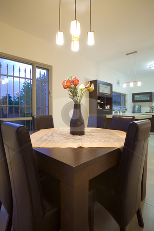 Dinner table stock photo, Tne new design dinner room and kitchen by Dmitry Pistrov