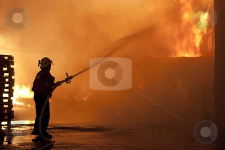 Danger work stock photo, Silhouette of firefighters by Dmitry Pistrov