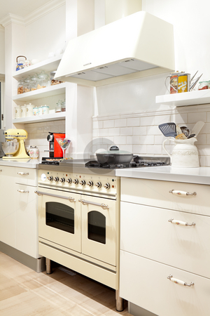 New kitchen in a modern home stock photo, Modern design kitchen with white and wood elements by Dmitry Pistrov