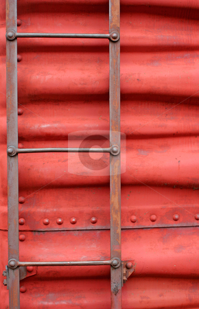 Ladder on the side of a train boxcar stock photo, A Ladder on the side of a train boxcar by Jim Mills