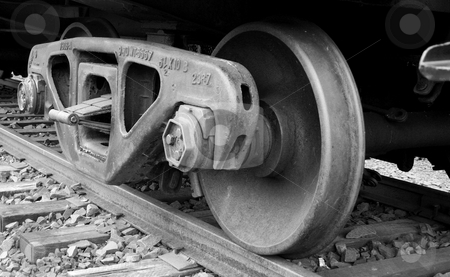 Train wheels on the track stock photo, A set of Train wheels on the track by Jim Mills