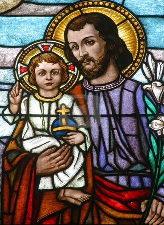 Saint Joseph holding baby Jesus stock photo, Stained glass with Saint Joseph holding baby Jesus by Zvonimir Atletic