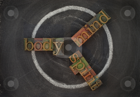 Body, min, soul - wellness cycle stock photo, Wellness cycle concept (body, mind, spirit) - vintage wooden letterpress type blocks, white chalk drawing on blackboard by Marek Uliasz