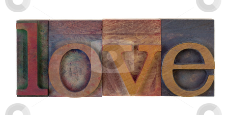 Love in vintage type blocks stock photo, The word love in vintage wooden letterpress type blocks, stained by color ink, isolated on white by Marek Uliasz