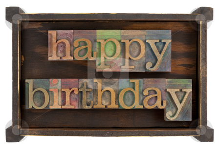 Happy birthday in letterpress type stock photo, Happy birthday in vintage lettepress type block inside rustic wooden box, isolated on white by Marek Uliasz