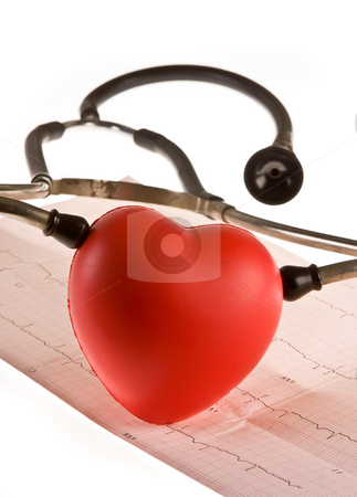 Heart diagnosis stock photo, Stethoscope and heart lying on a cardiogram by Anneke