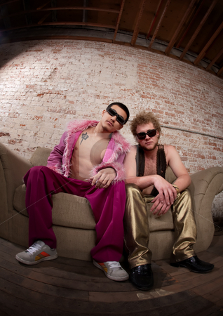Chill stock photo, Two cool party goers sitting on a sofa by Scott Griessel