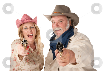 Man and woman aiming guns stock photo, Couple in western wear pointing pistols and laughing by Scott Griessel