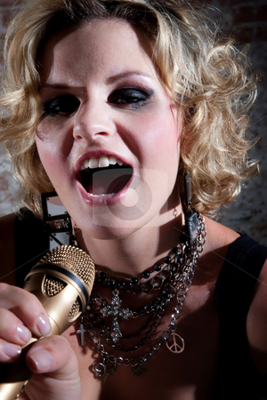 Female punk rocker stock photo, Close up of a female punk rocker performing a song by Scott Griessel