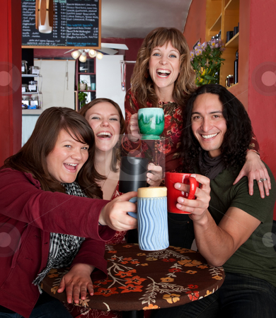 Four friends stock photo, Four friends with mugs toasting at a cafe by Scott Griessel