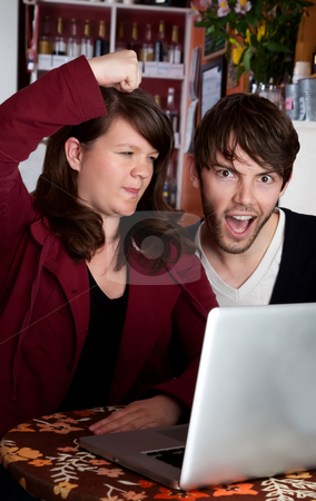 Internet abuse stock photo, Angry woman threatening spouse over internet abuse by Scott Griessel