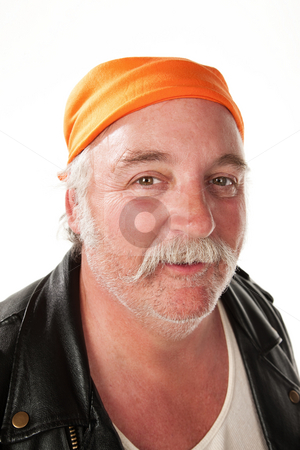 Smiling man stock photo, Smiling biker gang member with leather jacket by Scott Griessel