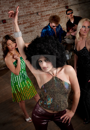 1970s Disco Music Party stock photo, Pretty girl with afro wig at a 1970s Disco Music Party by Scott Griessel
