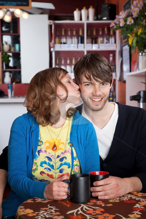 Happy couple stock photo, Love and kisses with coffee at a cafe by Scott Griessel