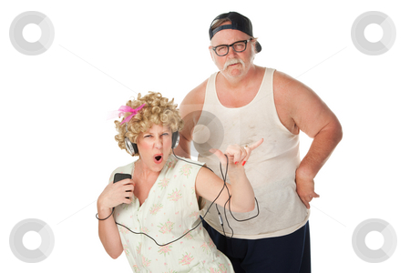 Hillbilly wife dancing with annoyed husband stock photo, Wife dancing to music with an annoyed husband by Scott Griessel