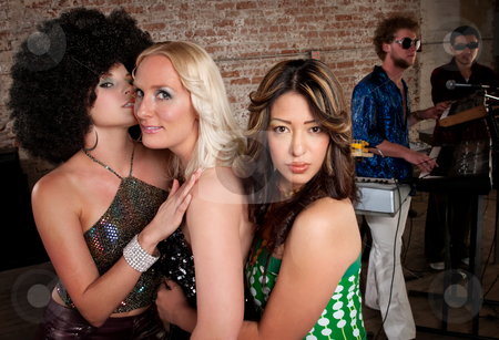 1970s Disco Music Party stock photo, Cute girls embracing at a 1970s Disco Music Party by Scott Griessel