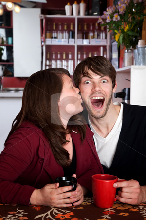 Surprise Kiss stock photo, Well deserved kiss in a coffee shop by Scott Griessel