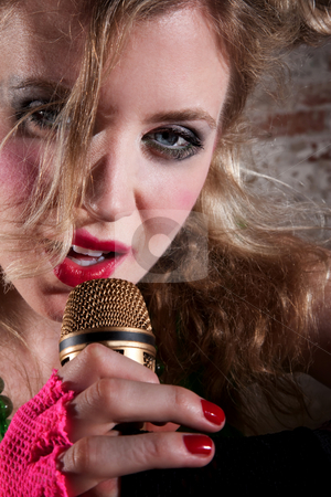 Female punk rocker stock photo, Close up of a young female punk rocker singing by Scott Griessel