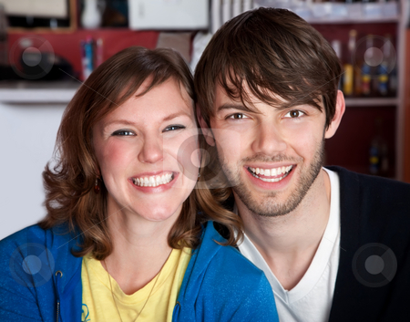 A very happy young hipster couple stock photo, A very happy young hipster couple sitting toether by Scott Griessel