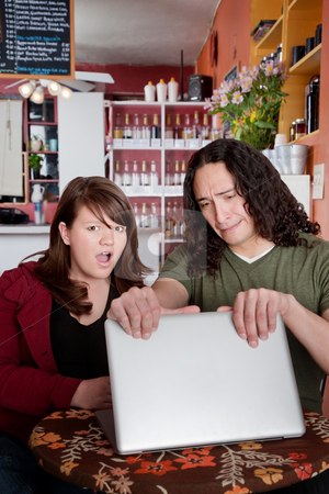 Shameful content stock photo, Hiding shameful content on a laptop from a friend by Scott Griessel